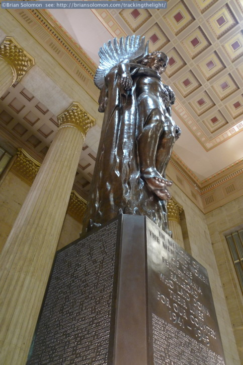Interior of 30th Street Station. The commemorative statue depicts an angel carrying a soldier skyward which symbolizes PRR's employees who perished in action during World War II.