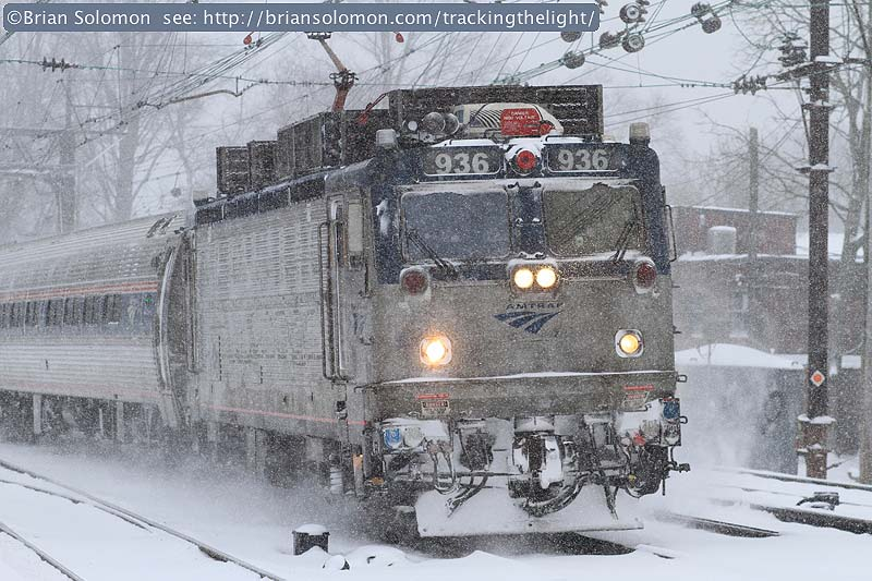 Late-running Amtrak Keystone service crosses over at Overbrook. Canon EOS 7D photo.