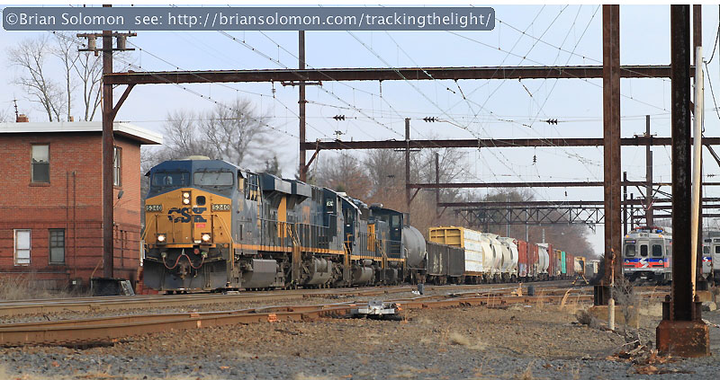 CSXT symbol freight Q439   works south behind mixed consist of GE and EMD locomotives. Canon EOS 7D with 100mm lens.
