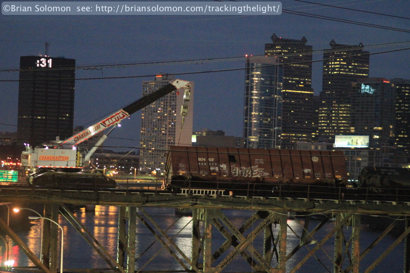 Dusk on January 20, 2014, clean up crews attend to derailed cars on the Schulykill River Bridge. ISO 6400, Canon EOS 7D with 100mm lens.