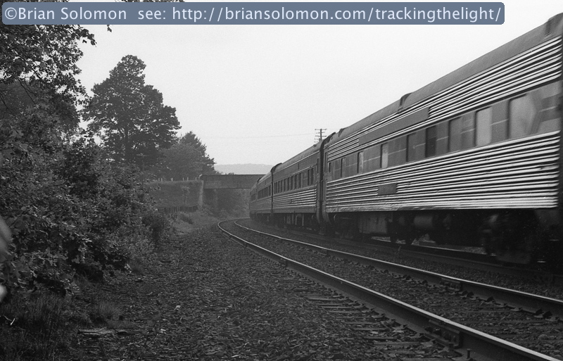 As 449 blitzed by, I made this trailing view looking toward the Route 20 overpass. My old Leica was a chore to use: Loading the camera was tricky; exposures had to be calculated manually with a hand-held photo cell; and focusing require lining up two ghostlike images while staring through a quarter inch auxiliary viewfinder. Processing the film was another unforgiving multi-step process.
