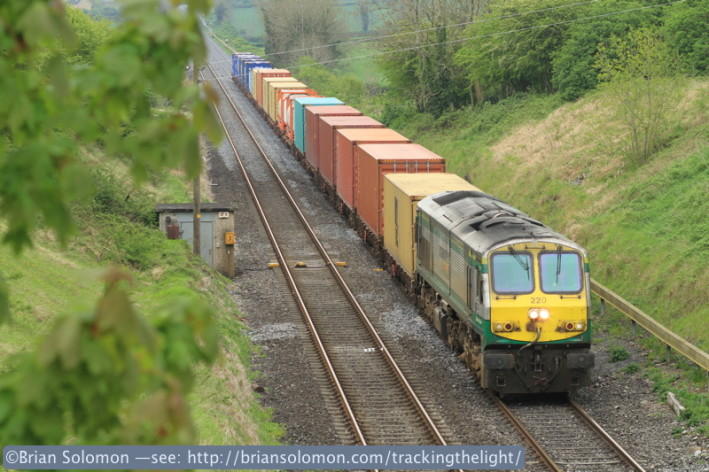 Irish Rail 220 leads Monday's Dublin-Ballina IWT liner seen west of Kildare, near Cherryville Junction. Exposed with a Canon EOS 7D with 100mm lens.