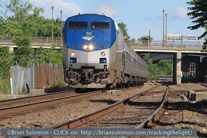 On the morning of June 22, 2014, Amtrak P42 150 leading train 145 on the former New Haven Railroad at Springfield, Massachusetts passes below Memorial Bridge.