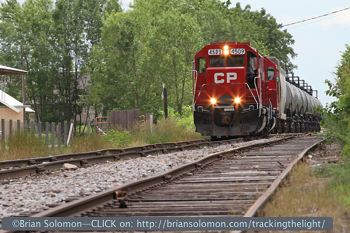 Canadian Pacific 4509 limps along on rough jointed track near DeForest, Wisconsin on June 23, 2010. I was using a long telephoto (200mm) lens and I opted for a low angle to accentuate the effect of the jointed track. Train speed was about 10 mph. My exposure was f10 at 1/250th of a second at ISO 200.