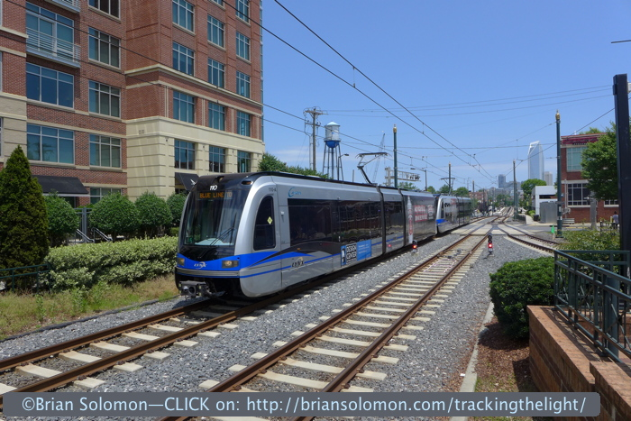 Lynx outbound near Tremont with Charlotte skyline.