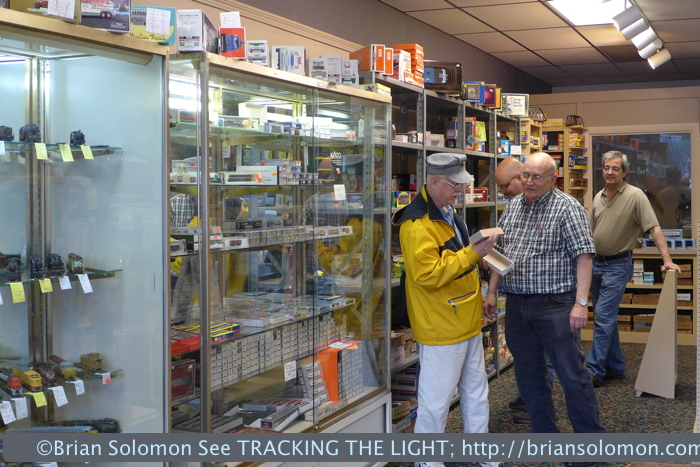 Palmer Hobbies' Bill Lanza assists a customer.