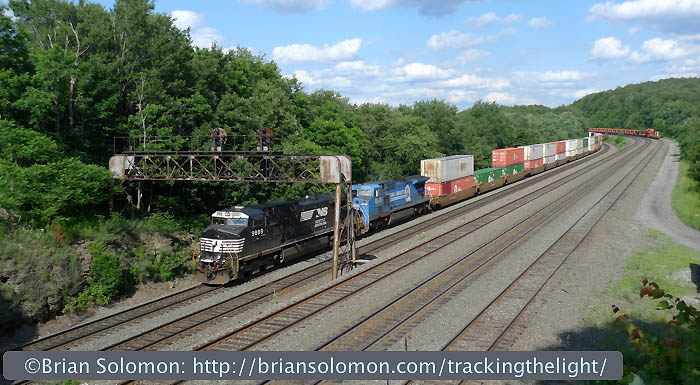 A westward Norfolk Southern freight approaches the Route 53 overpass near west of Gallitzin, Pennsylvania on June 30, 2010. I've heard that the highway overpass was recently replace/upgraded. Does anyone know how this affected this view point that was made from the old bridge abutments east of the bridge?