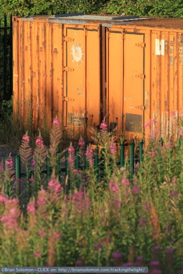 A blast of evening sun illuminates an old CIE 20 foot container along the line. Canon EOS 7D with 200mm lens.