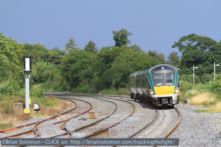 The 1600 Dublin-Cork ICR approaches Sallins at speed. An automatic voice warns, 'please stand back, train now approaching.' Canon EOS 7D with 200mm lens.