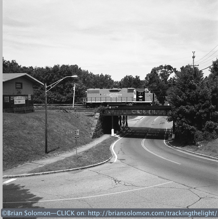 Mass-Central GP38 1751 crosses the Route 32 bridge in Ware, Massachusetts on July 10, 2014. Exposed on Tri-X using a Rolleiflex Model T with Zeiss Tessar lens.
