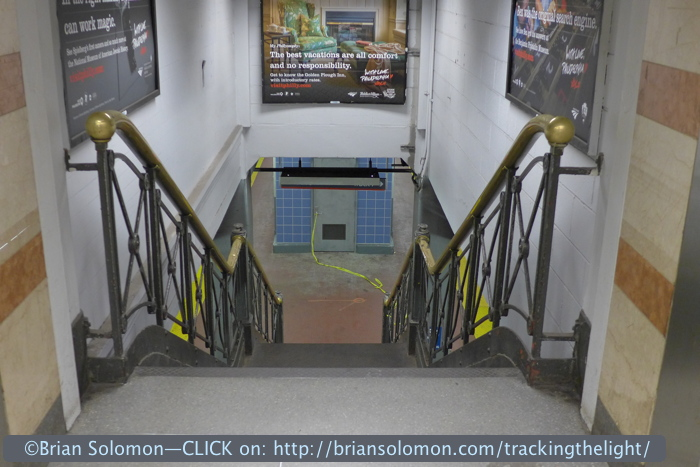 Brass railings, a vestige of earlier times. Drop down into the roar and odors that characterize New York Penn-Station and board a train for New Jersey! (That's what I did).