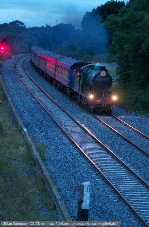 Exposed at 9:51pm on July 27, 2014 with a Canon EOS 7D with f2.0 100mm lens, set at ISO 3200 1/80th of a second at f2.0. White balance set for 'daylight.' To keep the locomotive sharp, I panned slightly. I processed the camera RAW file in Photoshop to lighten the image slightly and improve contrast.