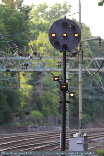 Rule 290, Restricting, displayed in classic Pennsylvania Railroad fashion using a reverse diagonal row of lights on the second head.