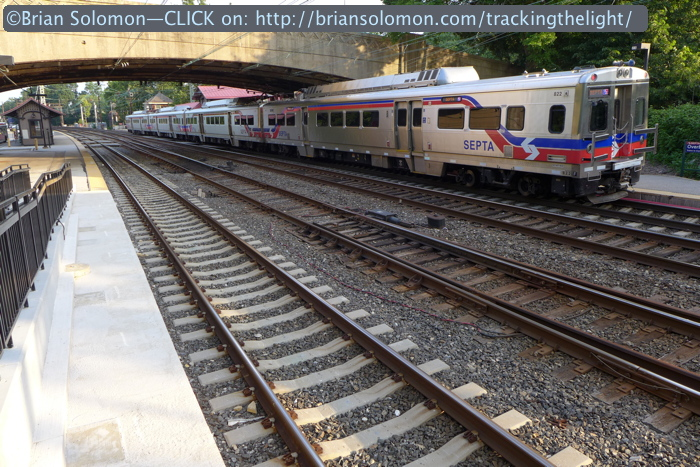 An inbound SEPTA local pauses at Overbrook station. The shinny silver train makes for a dynamic subject, but does this convey the spirit of Overbrook? Lumix LX-7 photo on July 1, 2014.