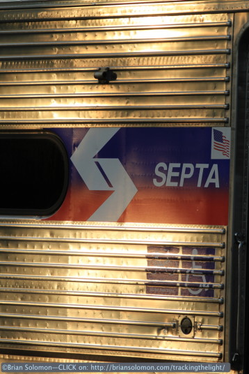 SEPTA logo catches the evening glint at Overbrook on July 1, 2014. Canon EOS 7D with 200mm lens.
