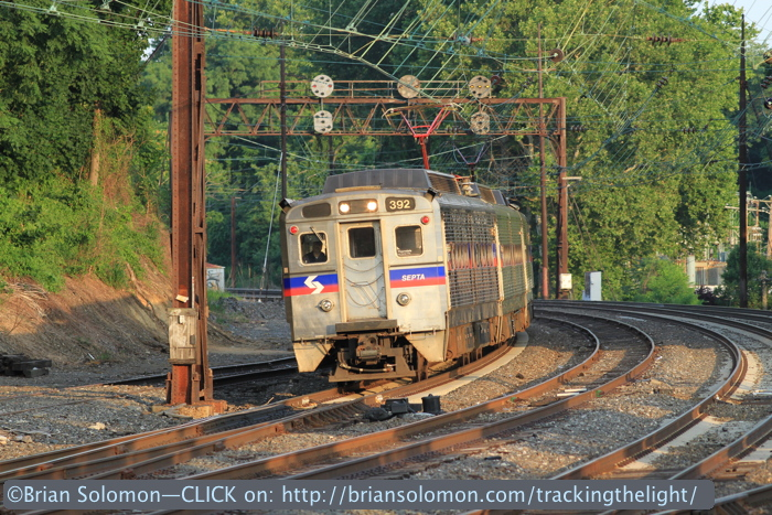 Outbound SEPTA local at Overbrook catches the evening sun on July 1, 2014. Canon EOS 7D with 200mm lens.