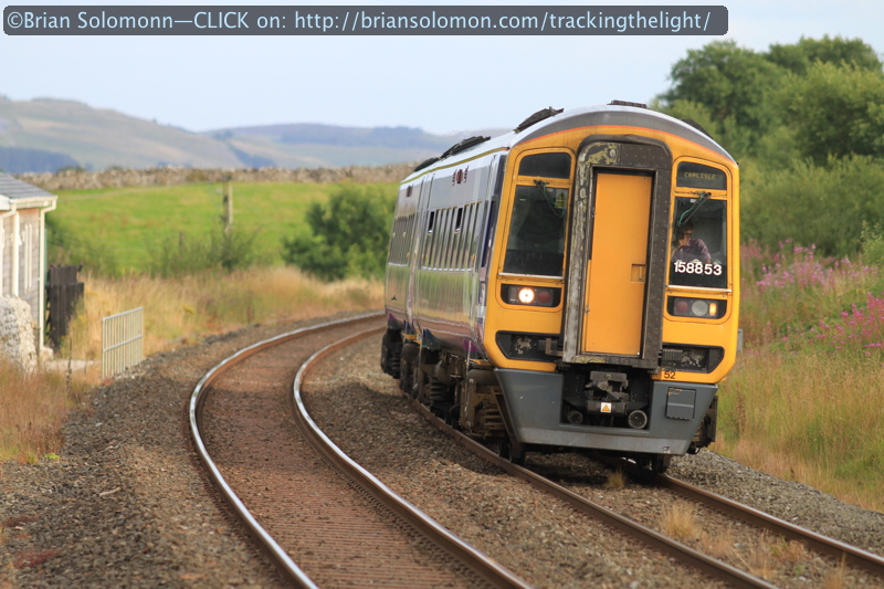 In the evening, a class 158 emu approaches its station stop at Ribblesdale. Canon EOS 7D with 200mm lens.