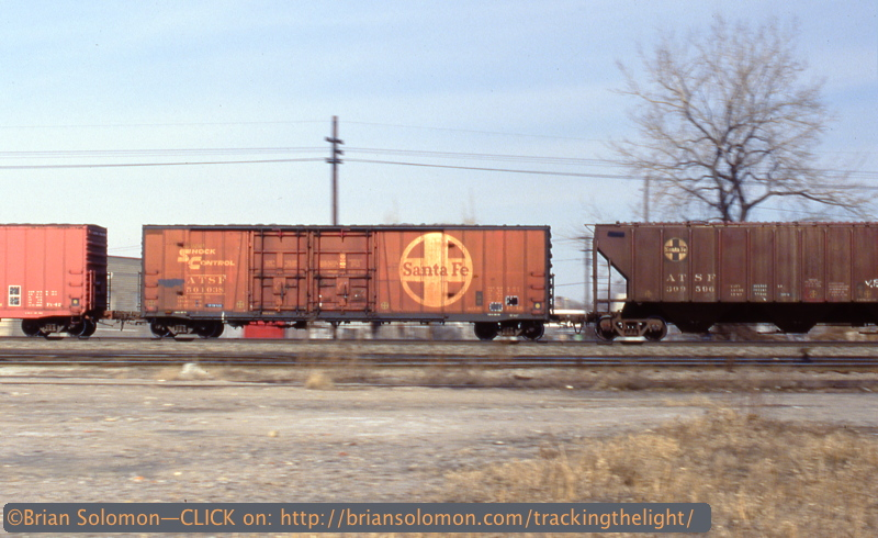 I exposed this slide of Santa Fe freight cars on a westward Conrail freight with the Canon and 50mm lens. I panned using a 1/30th of second to convey a sense of motion.
