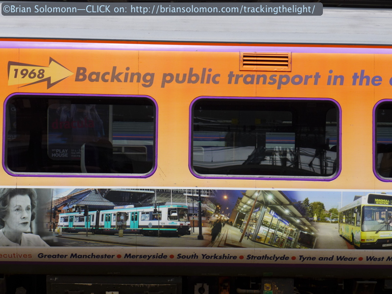 Murals cover some trains with regional themes. Lumix LX7 photo.