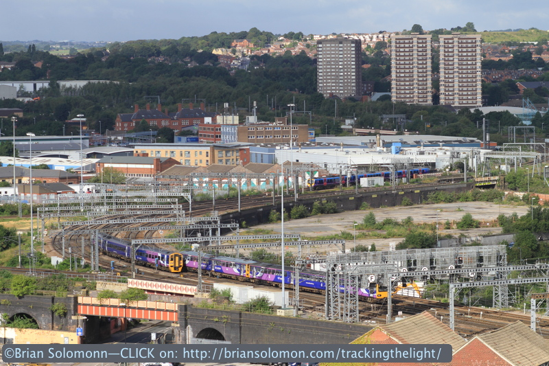 Trains pass near Leeds station as viewed from the 13th floor of the Double Tree Hotel. Canon EOS 7D photo.