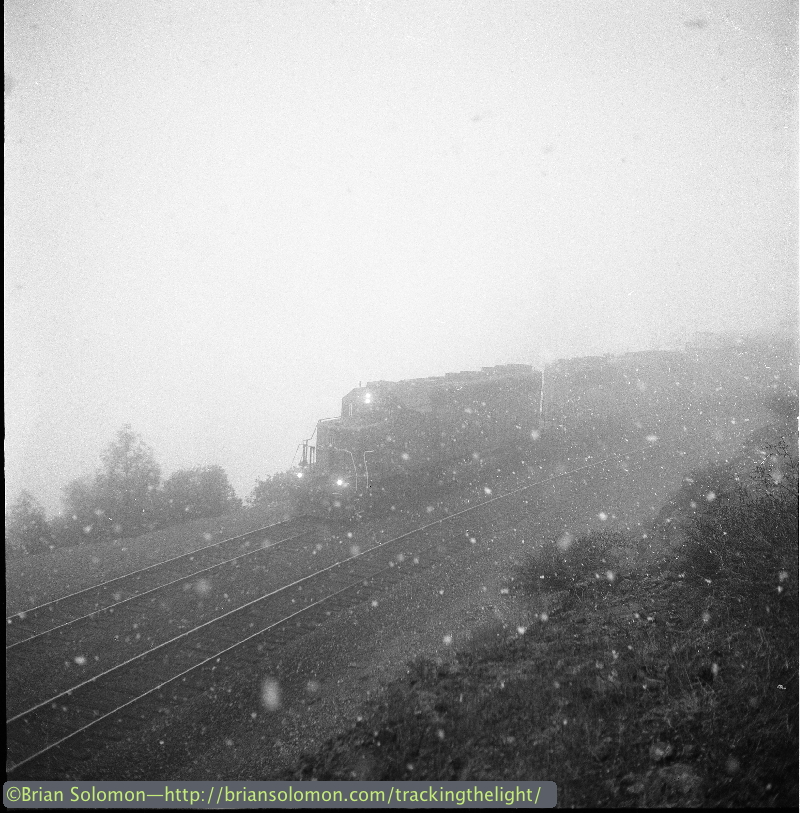 Union Pacific SD40-2s emerge from the fog and snow at 'American' on their ascent of Donner Pass.