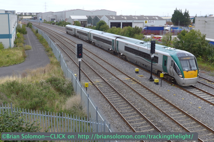 Irish Rail ICR's roll along a speed near Clondalkin. The camera's small size makes it easier to shoot through fences, such as those on highway bridges over the track. LX7 Photo.