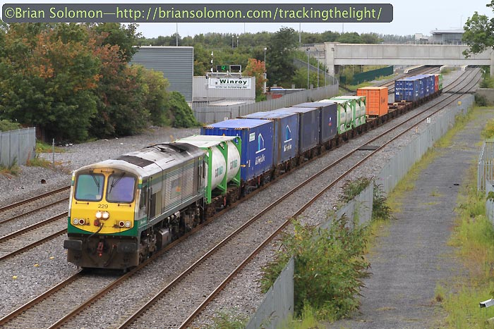 Irish Rail 229 leads IWT liner.
