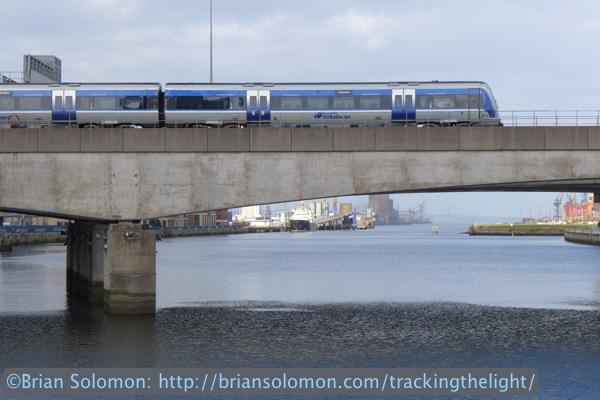 An NIR train crosses the River Lagan in Belfast. Lumix LX7 photo.