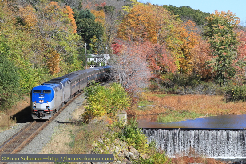 Amtrak 449 The Lake Shore Limited rolls west along the Quaboag River at West Warren, Massachusetts on the afternoon of October 12, 2014. Exposed with a Canon EOS 7D with 100mm lens.