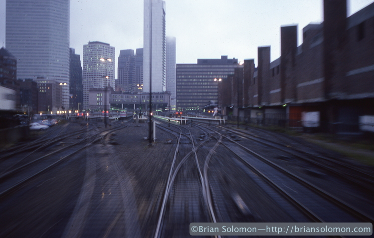 I exposed this on Kodachrome 25 using my Nikon F3T with 35mmPC (perspective control—shift lens). By adjusting the front element, I maintained the verticals on the skyscrapers in the distance. I like the effect of motion; a train traveling through time.