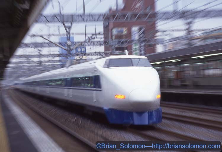 I prefocused and zoomed the lens to keep pace with the nose of the train. Although it may not be immediately evident, this train is moving away from the camera.