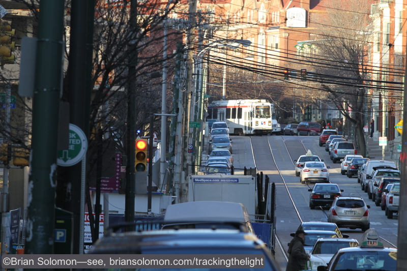 An in bound SEPTA streetcar catches the sun as it turns onto 36th Street. Canon EOS 7D with 200mm lens.