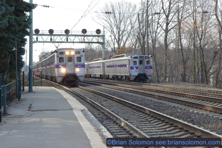 SEPTA locals pass at Narberth. Classic postion light signaling still protects the mainline.