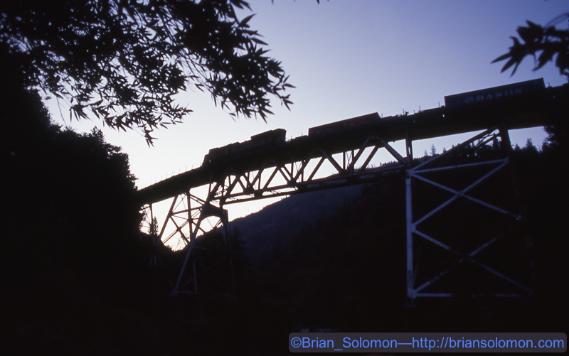 Exposed on Fujicrome with a Canon EOS 3 with 28mm lens. I gauged my exposure on the sky, intending to make a silhouette of the train and bridge.