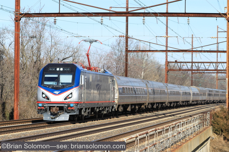 Clean Amtrak ACS-64 leads train 91, the Silver Meteor at Torresdale, PA. Canon EOS 7D with 100mm lens.