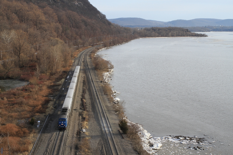 A Metro-North northward train approaches the tunnels at Breakneck Ridge. Canon EOS with 40mm pancake lens.