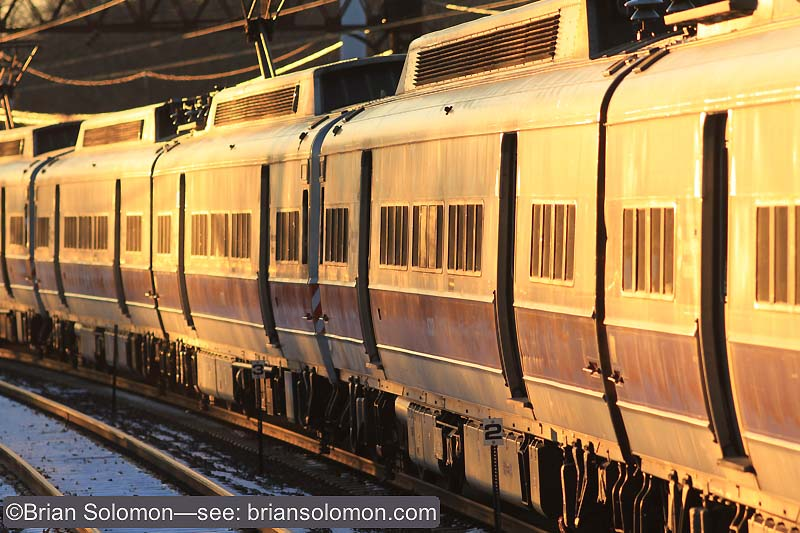 The glinting sides of the old grime coated multiple unit are slightly less reflective than the newer cleaner train. Also the angle of the sun is lower. By fixing the white balance at the daylight setting, I can retain the rosy sunset coloration. If I'd used the auto setting, this would have canceled some of the effect of sunset, and I don't really want to do that.