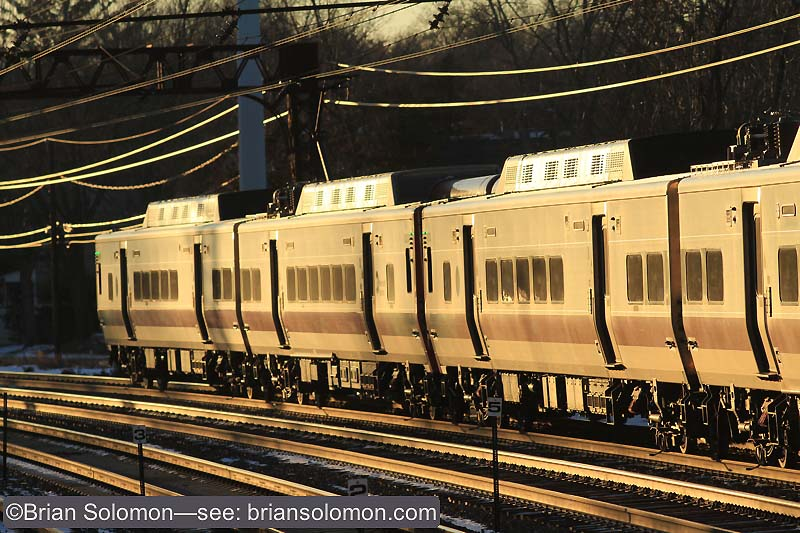 Here I need to stop down about a full stop from the head on view. The metallic sides of the Metro-North multiple unit reflected more light than initially anticipated and I needed to compensate on the spot by using my in camera meter to gauge the lighting. The trick is not to over do it. If I stopped down too much, I'll lose shadow detail and the image will appear too dark. Canon EOS 7D with 200mm lens. ISO 200, f5.6 at 1//1000th of a second. White balance set at daylight.