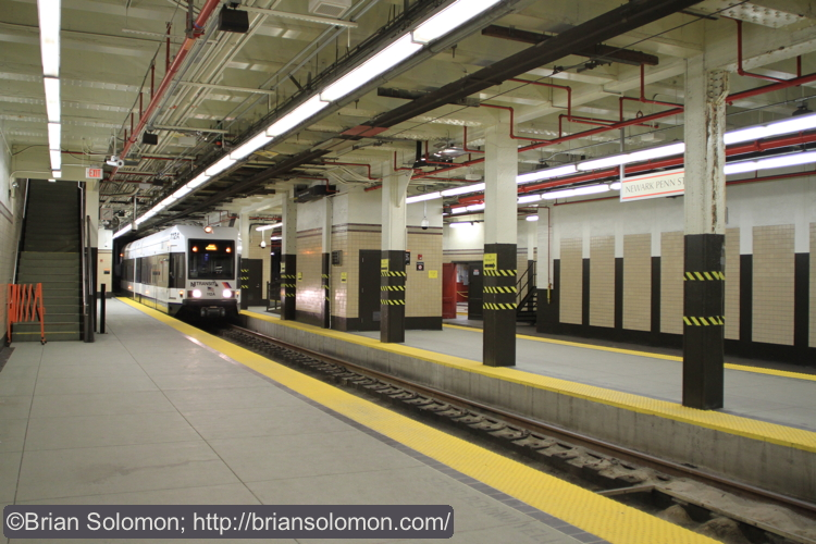 An inbound light rail car arrives at the Newark Penn Station terminus. Twin turn back loops are in operation here. Canon EOS 7D with 20mm lens.
