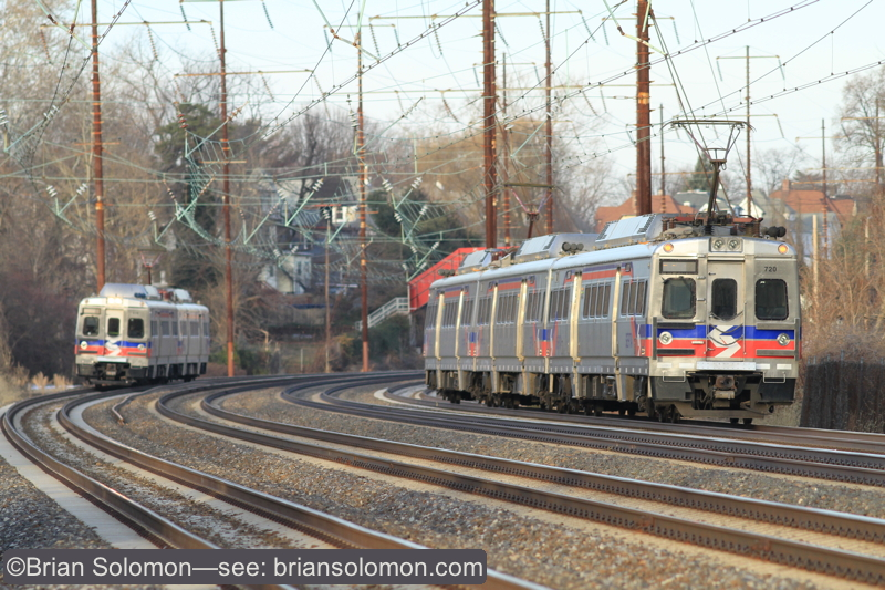 SEPTA Silverliner Vs pass near Crum Lynne, Pennsylvania. The train on the left is approaching its station stop, while the train on right accelerates toward 30th Street Philadelphia. Canon EOS 7D with 200mm lens. ISO 400.