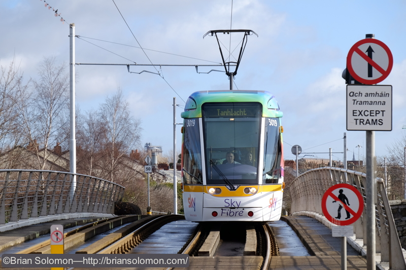 The specially painted 'Sky' tram crosses the LUAS bridge over the Grand Canal at Suir Road. Exposed with a Fuji Film X-T1 digital camera; ISO 400.