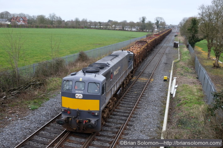 Finally, after the passage of several more passenger trains, the laden timber departs Kildare, taking the crossover from uproad to downroad. The time was 10:58 am.