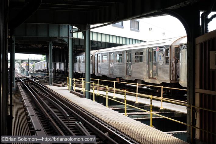 An R32 works a J-train service.