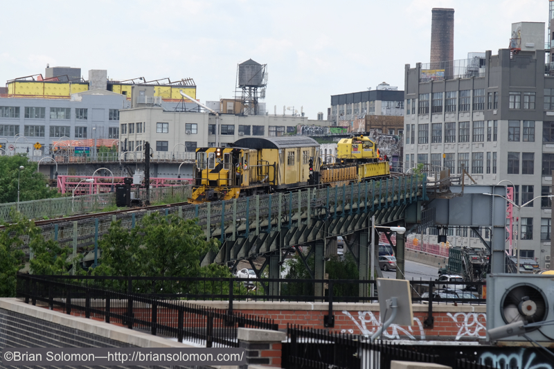 NYCTA_maint_train_at_Marcy_Ave_on_el_distant_DSCF1374